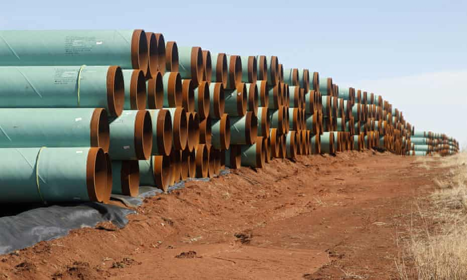 Miles of pipe ready to become part of the Keystone Pipeline are stacked in a field near Ripley, Okla. (AP Photo/Sue Ogrocki, File)